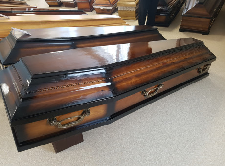 Varnished wooden coffins