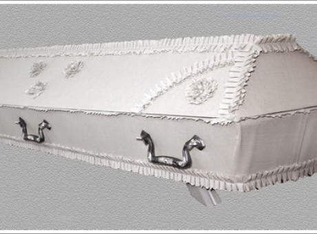 White draped coffin