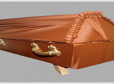 Orange draped coffin