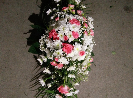 Funeral spray with white and pink flowers