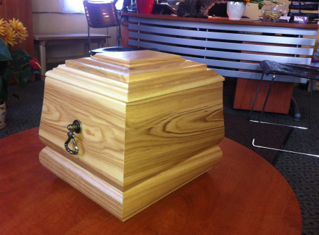 Wooden urn with decor