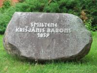 Piemiņas akmens Kr.Baronam Logo