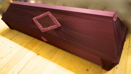 wooden casket covered with cloth