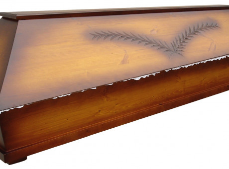 Wooden coffin with engraving