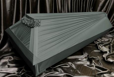 Green draped coffin